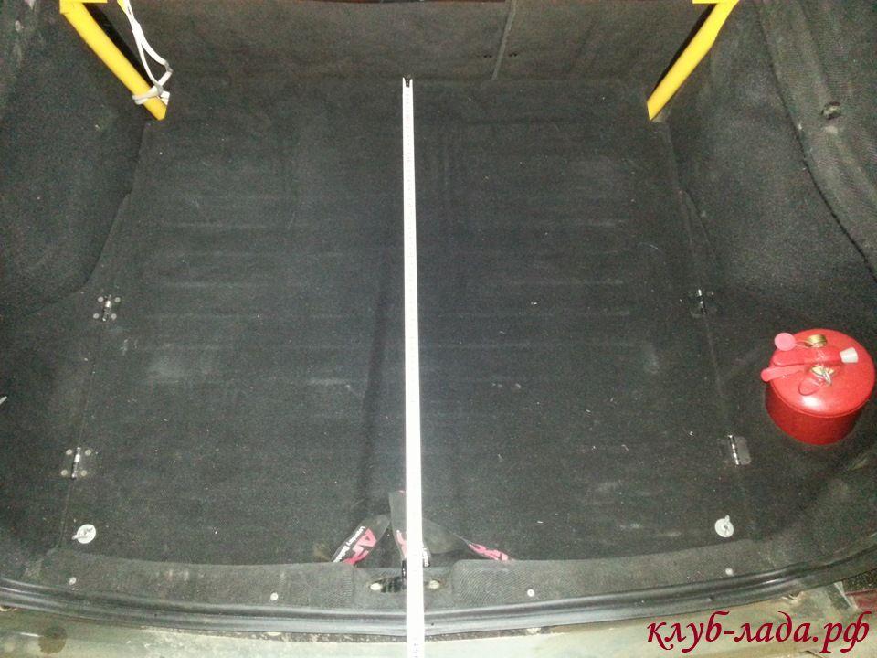 Длина крышки пола от спинки сидений до замка багажника - 84см